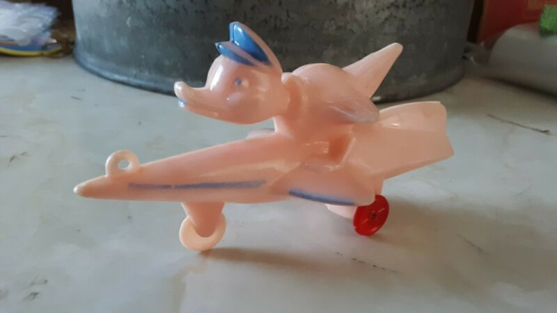 vintage Rosbro hard plastic DUCK ON SPACE ROCKET candy container red wheels