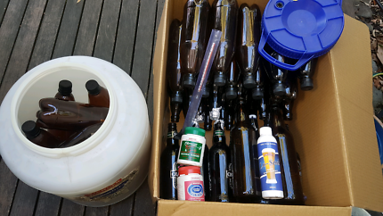 Beer brewing kit with glass bottles