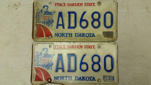 Pair 1987 NORTH DAKOTA Peace Garden State Roosevelt License Plate AD680