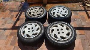 "14"" steel wheels with hub caps"
