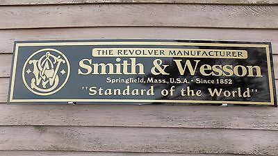 "EARLY STYLE SMITH & WESSON FIREARM DEALER SIGN/AD 1'X46"" ALUM. PANEL-ROUND LOGO"