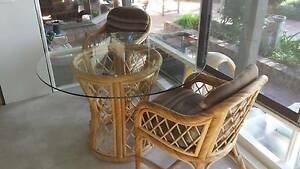 Glass topped table and matching cane chairs. Balmain Leichhardt Area Preview