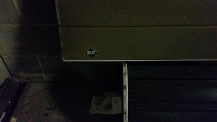 Panel lift garage door
