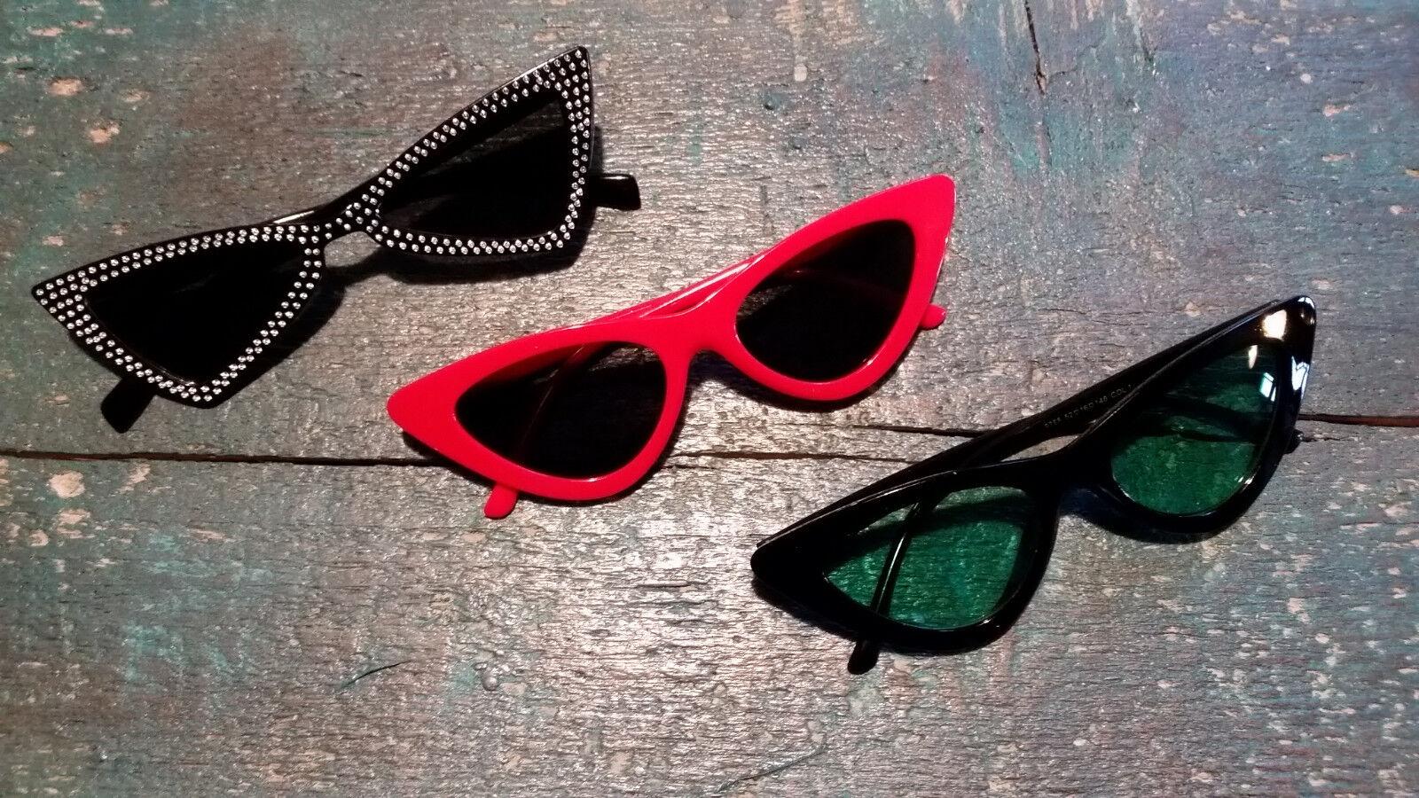 Sonnenbrille Katzenaugen geometrisch eckig rot grün mit Metallverzierung Trend