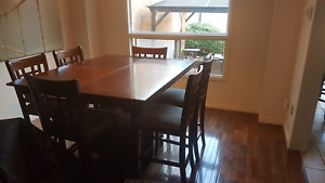 Wood dining room table - bar height with six chairs