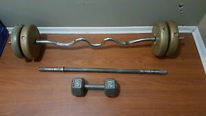 Kid cycle and curl bar and dumbbell
