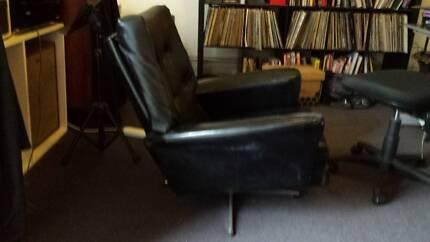 Comfy black vinyl armchair on swivel base Carlton Melbourne City Preview