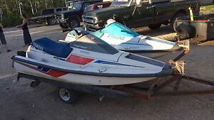 Pair of Yamaha water crafts and trailer