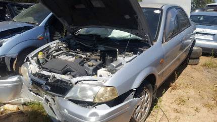 2001 FORD LASTER SILVER FOR WRECKING