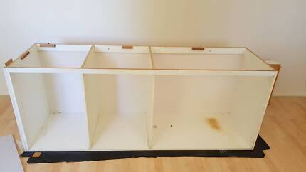 Kitchen cabinet frame with light gray doors and drawers