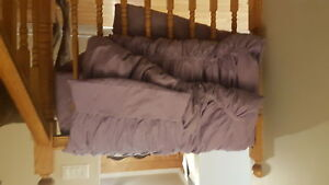 Twin comforter and decorative pillow sham.