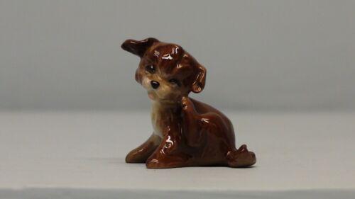 Retired Hagen Renaker Puppy Scratching