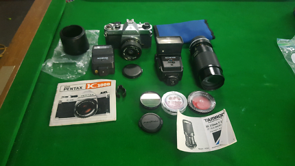 Asahi Pentax K1000 SLR camera with accessories