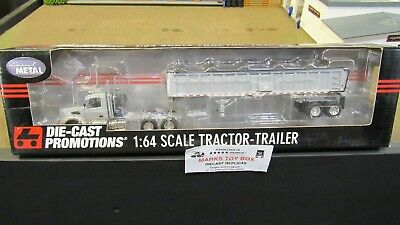 Used, DCP#31893 MTB SILVER VOLVO VT800 SEMI DAY CAB TRUCK EAST END DUMP TRAILER 1:64/ for sale  Shipping to Canada