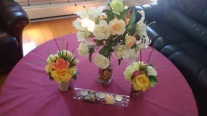 Vases with silk flowers and candles stand