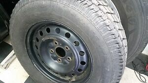 studded winter tire and rims jeep