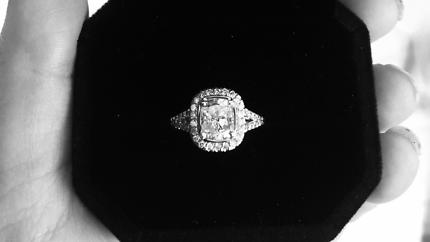 Sparkeling 1.75 carat cushion cut diamond inside 1 carat halo