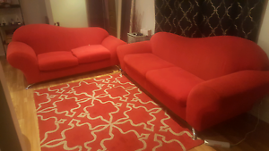 2x red sofas lounges and red rug Dianella Stirling Area Preview