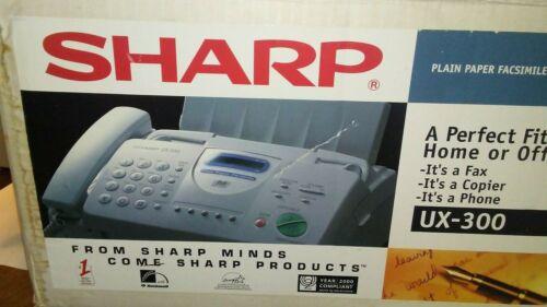 tan sharp ux-300 fax,phone,copier home machine