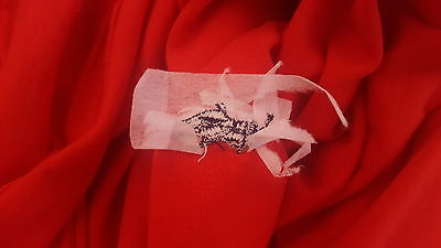 As you can see, the tag is very poorly stitched on. The logo is terribly sowed on.