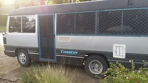 Toyota Coaster Motorhome,dual fuel, kitchen,shower,tested, low km Ferntree Gully Knox Area Preview
