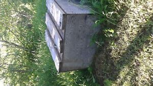 Wooden box very solid. Hard wood