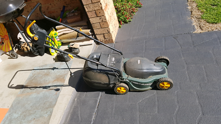 Electric lawn mower and edge trimmer