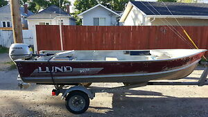 Lund wc 14 foot boat with 20 hp honda 4 stroke