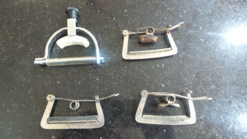 Group collection of 4 vintage Guitar Capo