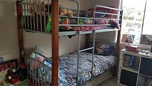 Timber legs and metal frame bunk beds with 2 used single matress Brisbane City Brisbane North West Preview