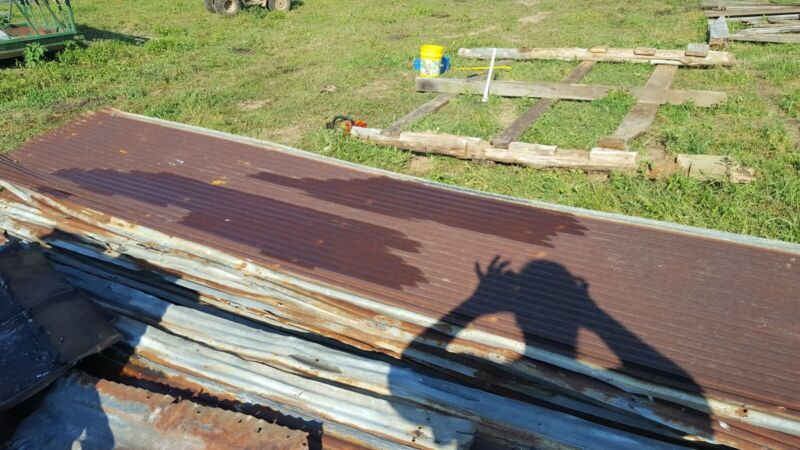 Antique rusted barn tin corregated metal roofing. 2-15 ft lengths X 26 in wide
