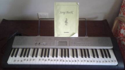 KEYBOARD AND MUSIC BOOK