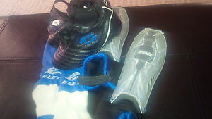 Size 8 cleats, shin guards and socks