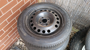Toyota Corolla 4x100 Stock wheels, Near new tyres Bundoora Banyule Area Preview