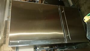 Large Stainless bottom mount freezer fridge.