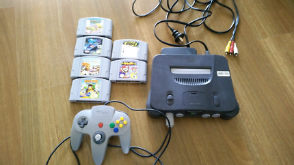 Nintendo 64 console with 6 games