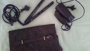 Hair straightener, travel hair dryer and case Raceview Ipswich City Preview