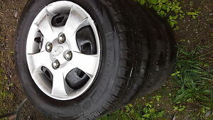 4 hyundai accent rims/hubcaps and lug nuts