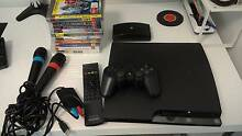 Playstation 3 console with games, 2 microphones, playTV, BDRemote Ryde Ryde Area Preview