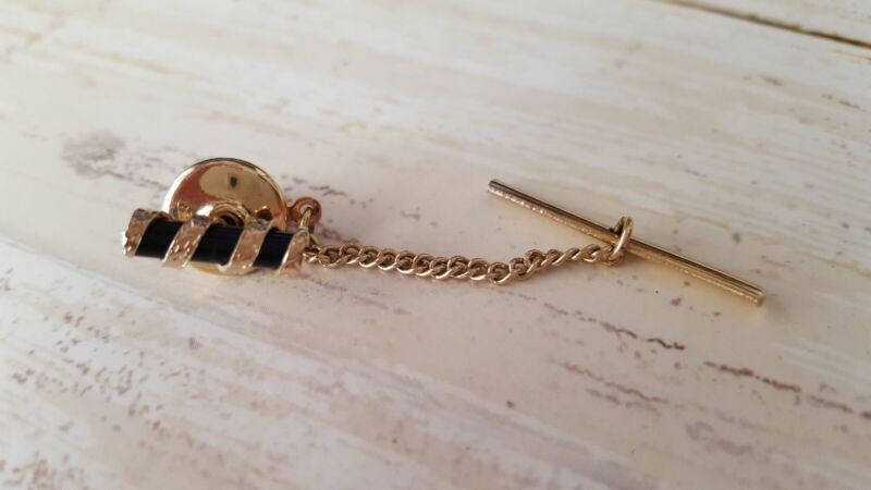 Vintage mens gold tone and back tie tack
