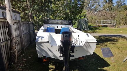 Fibreglass runabout boat on trailer