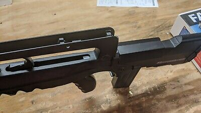 BRAND NEW NEVER BEEN FIRED! FAMAS F1 officially liscensed by Cybergun