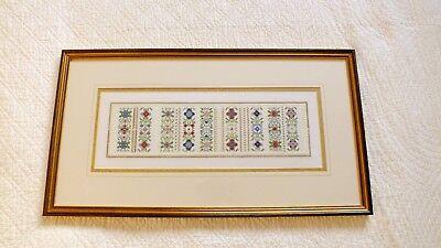 Large hand embroidered floral sampler professionally framed gilt wooden frame