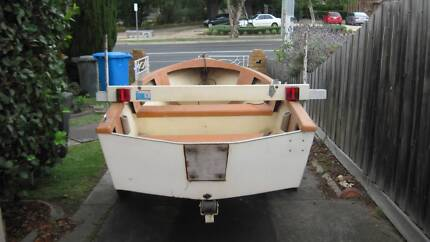 Fibreglass dinghy and handmade trailer.
