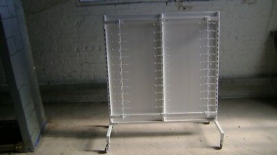 RETAIL STORE  TWO SIDED  WHITE DISPLAY RACK W HANGING ADJUSTABLE PEG BRACKETS