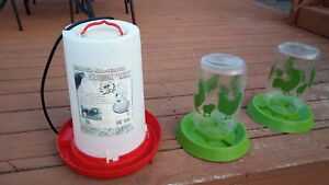 2 chicken feeders and heated water feeder