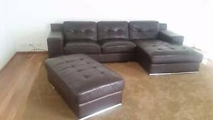 Dark brown leather sofa with ottoman Sylvania Sutherland Area Preview