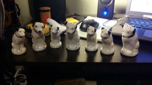 7 VINTAGE NIPPER SALT AND PEPPER SHAKERS IN GOOD CONDITION