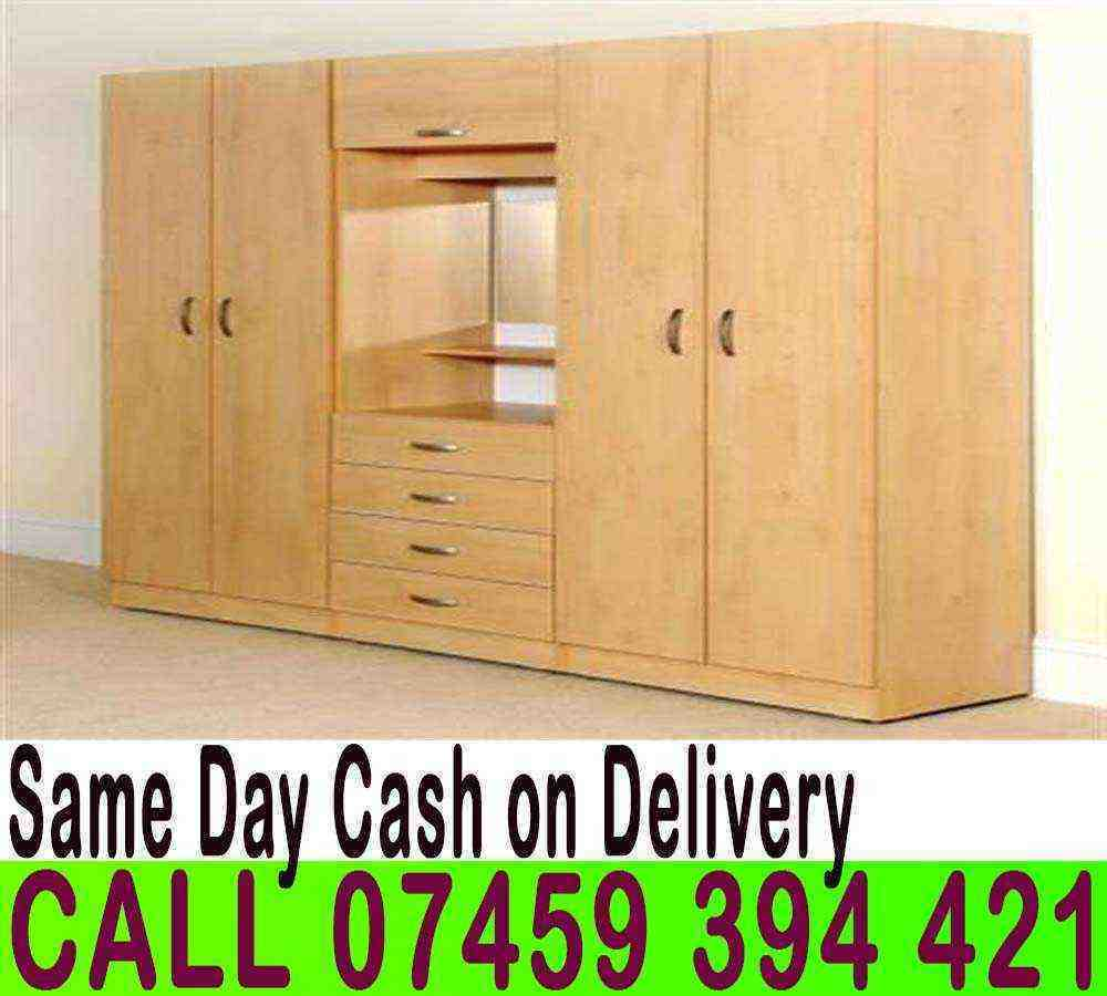 BRAND NEW Four Door Large Wardrobe Setin Enfield, LondonGumtree - DIAL 447459394421 V.I.S.I.T OUR S.T.O.RE Brand New Fully Assembled Prior to Delivery Key Feature Top shelf and hanging rail on both sides Dresser in the middle and a top hinged cabinet Mirror and bulb in the centre 4 drawers underneath Comes Fully...