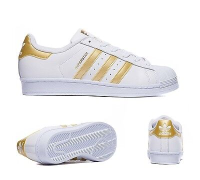 gold adidas superstar trainers